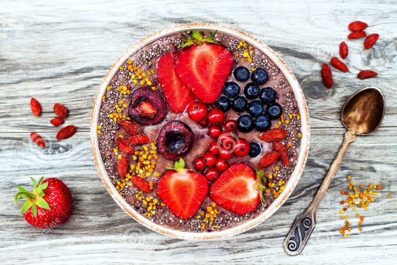 Acai-breakfast-superfoods-smoothies-bowl-chia-seeds-bee-pollen-goji-berry-toppings-peanut-butter-overhead-top-view-75011688